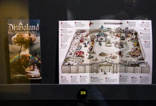 Mappa e locandina di Dimaland parco di non divertimento di Banksy